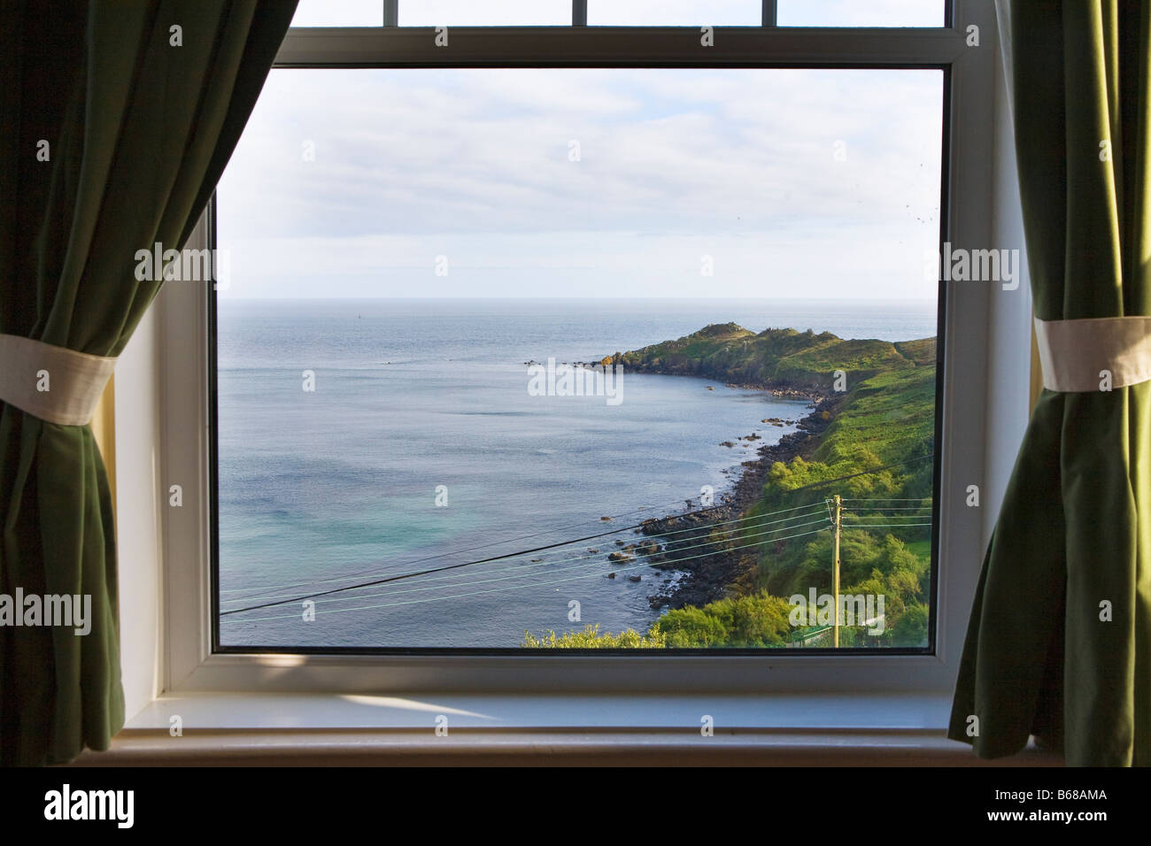 View from a window of the peninsula at Coverack on the coast of Cornwall, England Stock Photo