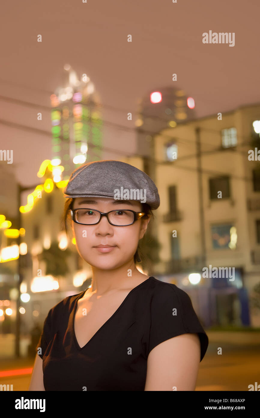 d6aaedef77529 Portrait of a young woman wearing a flat cap Stock Photo  21082510 ...