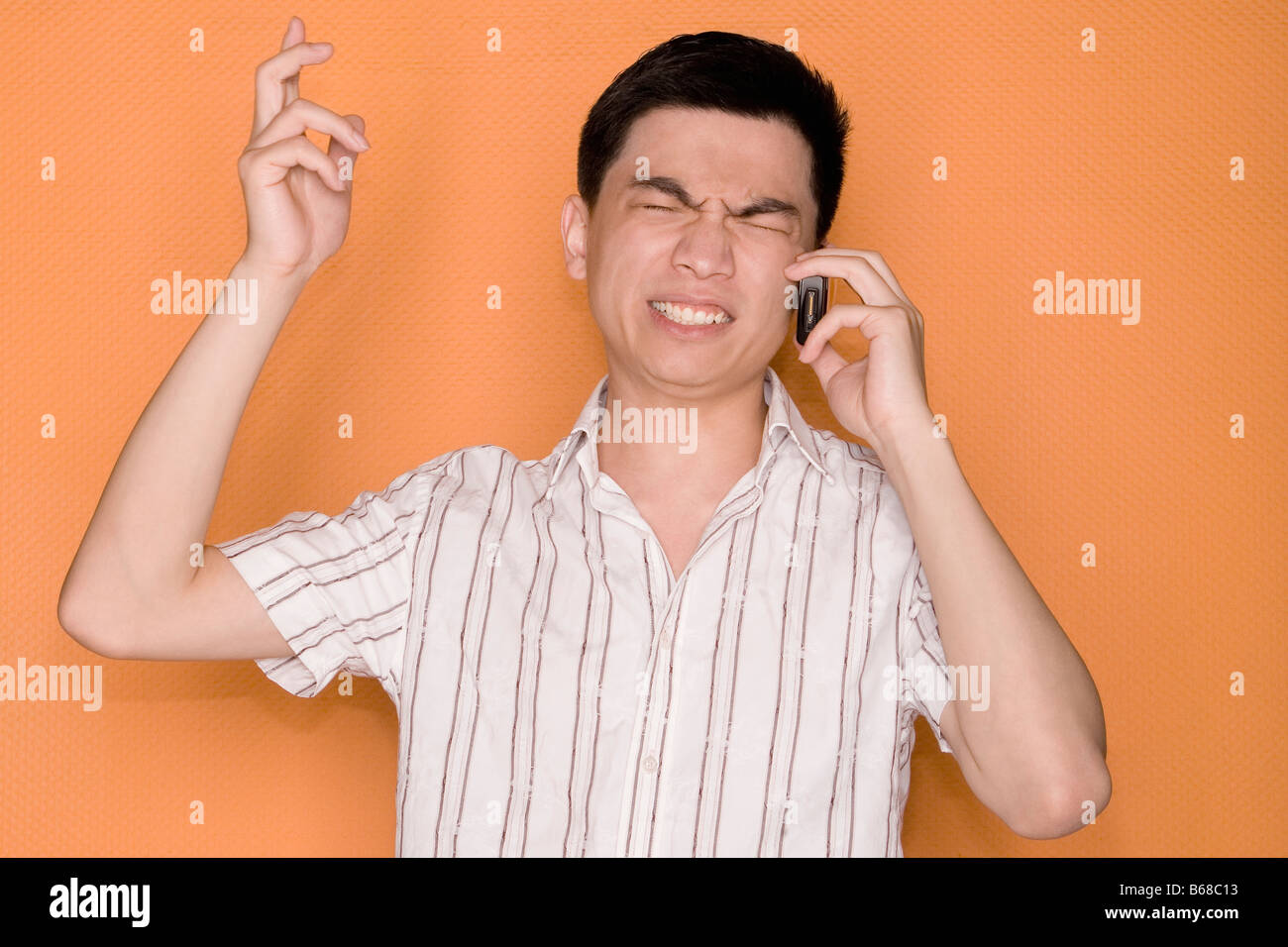 Close-up of a male office worker talking on a mobile phone - Stock Image