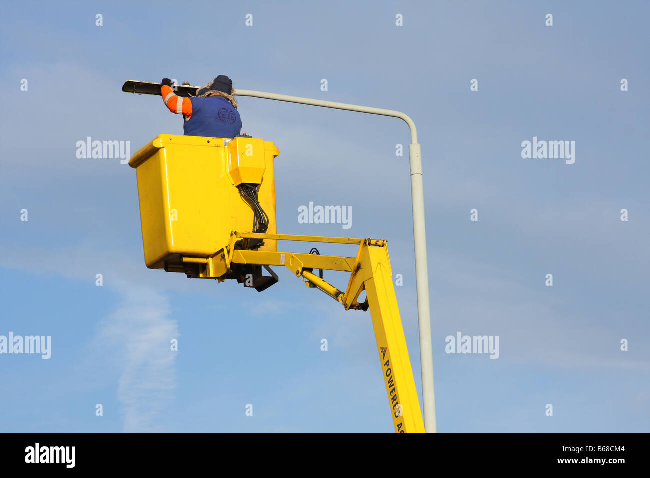 Street lighting maintenance work in a U.K. city. - Stock Image