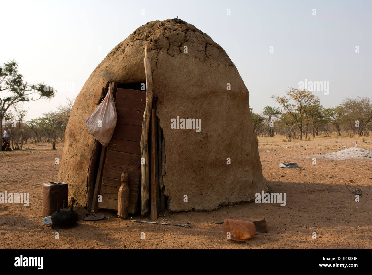 Traditional village huts built from mud and dung at the Himba Oase Village near Kamanjab Namibia Africa Stock Photo