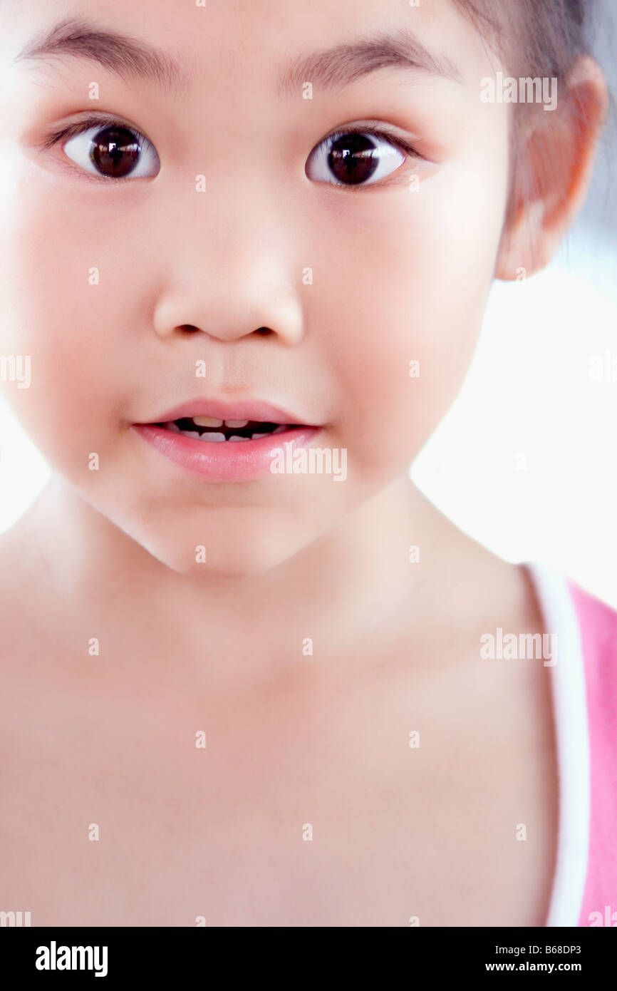 Portrait of a girl looking surprised - Stock Image