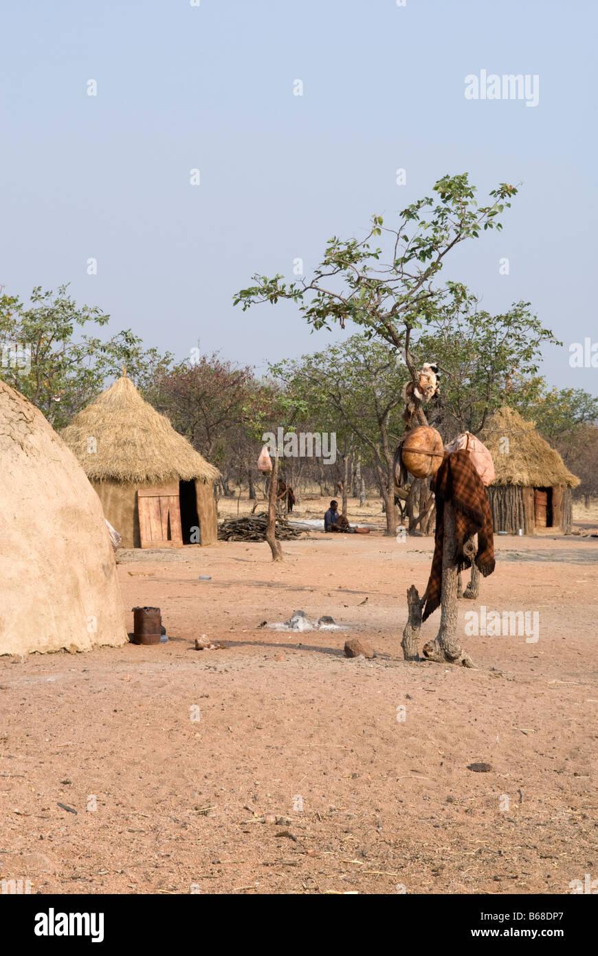Traditional village huts built from mud and dung at the Himba Oase Village, near Kamanjab, Namibia - Stock Image