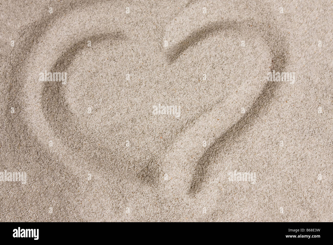 Heart written shape in the sand - Stock Image