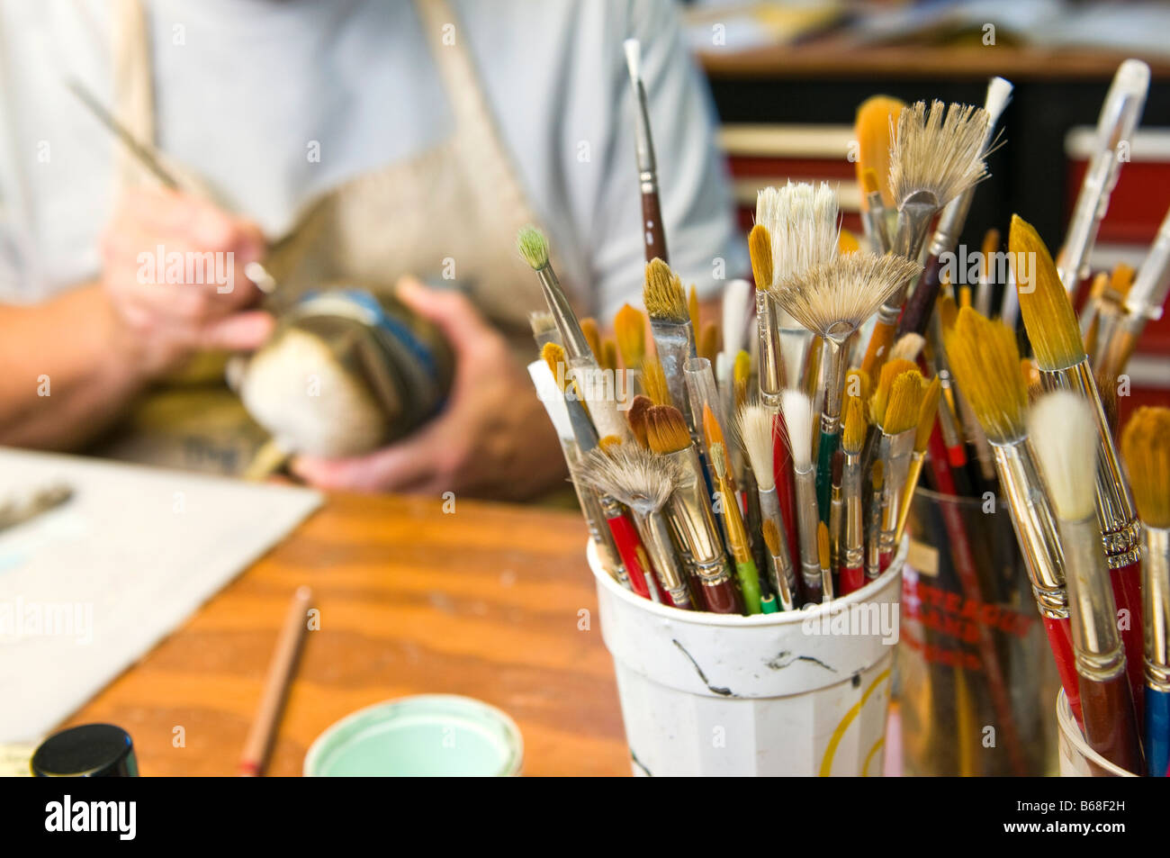 paint brushes in a decoy carvers studio Stock Photo