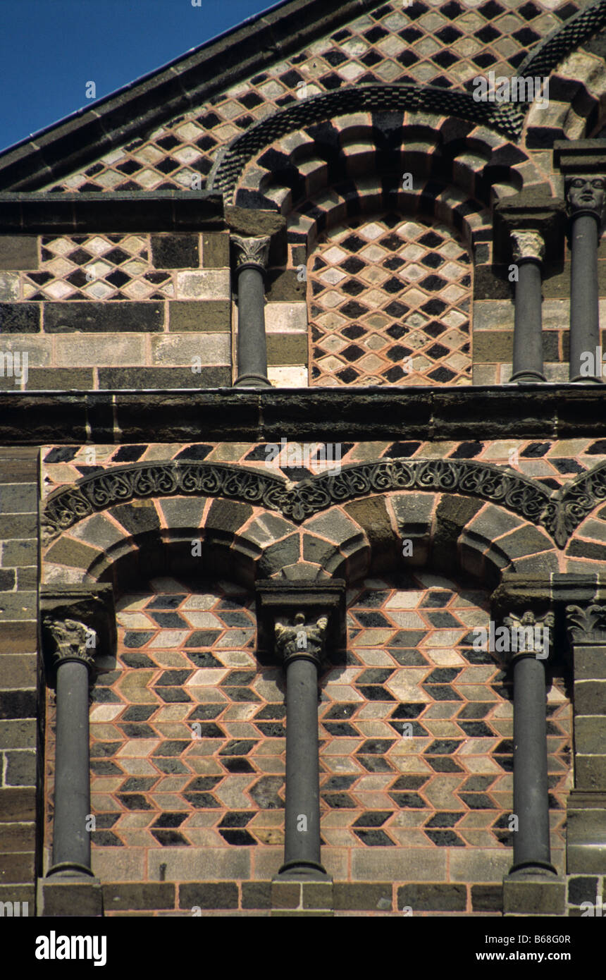 Polychrome stone detail & patterns, west facade of the Romanesque-Byzantine Notre-Dame Cathedral (c12th), Le - Stock Image