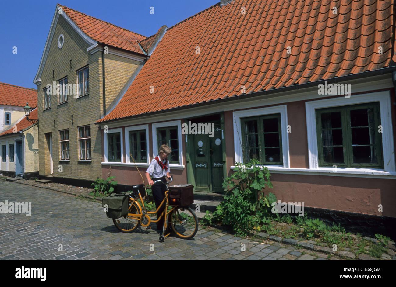 Elk167 2998 Denmark Aero Island Aeroskobing postwoman on her bicycle - Stock Image