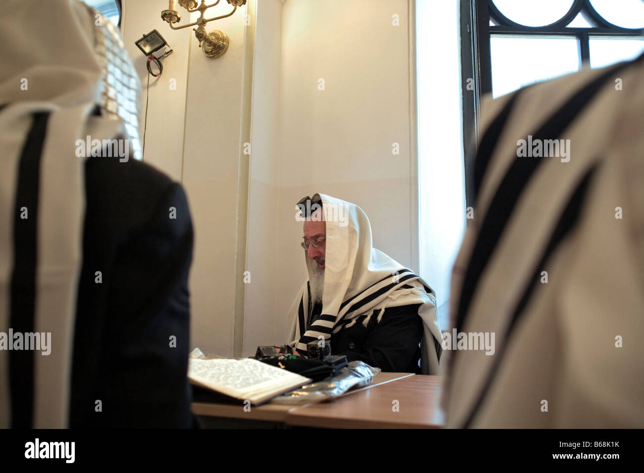 Scene during services in the Nozyk Synagogue in Warsaw. - Stock Image