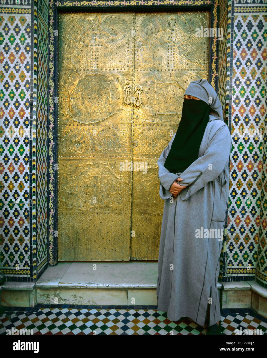 Veiled woman, Marrakesh, Morocco - Stock Image
