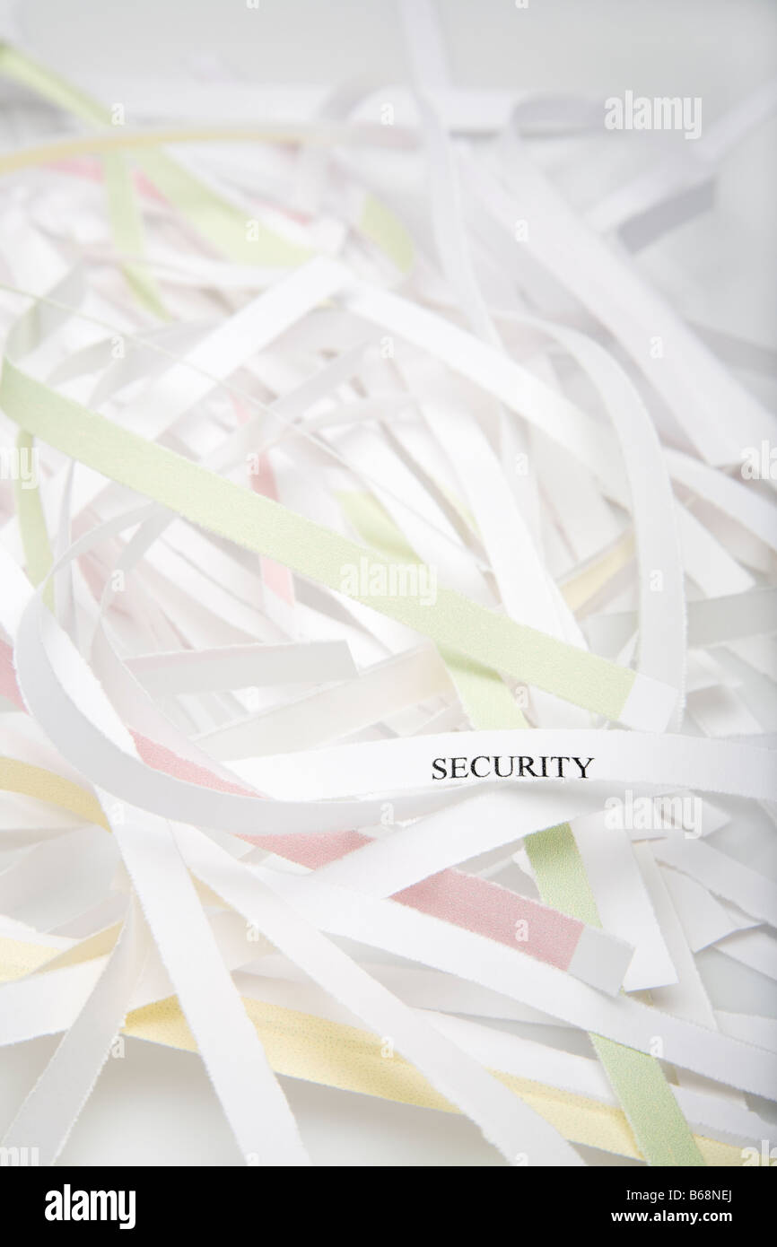 Shredded paper One shred showing the word security - Stock Image