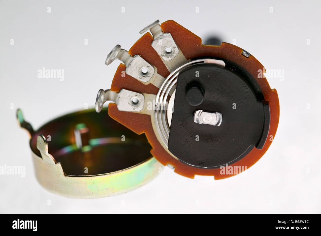 A disassembled potentiometer shows the inner workings - Stock Image