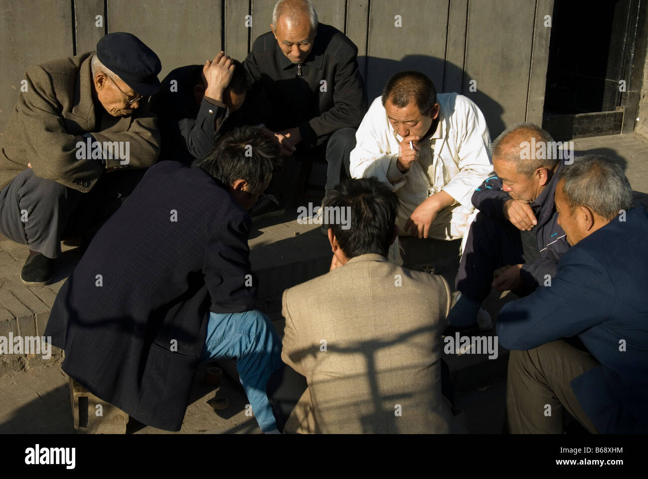 Men engrossed in a game of checkers, Pingyao, Shanxi Province, China - Stock Image