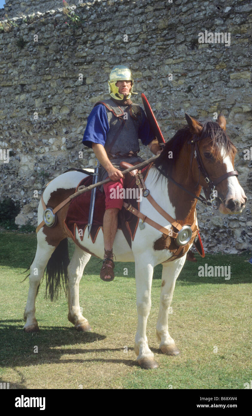 Roman cavalry soldier soldiers cavalryman historical re-enactment horse rider pony armed armour shield helmet England - Stock Image