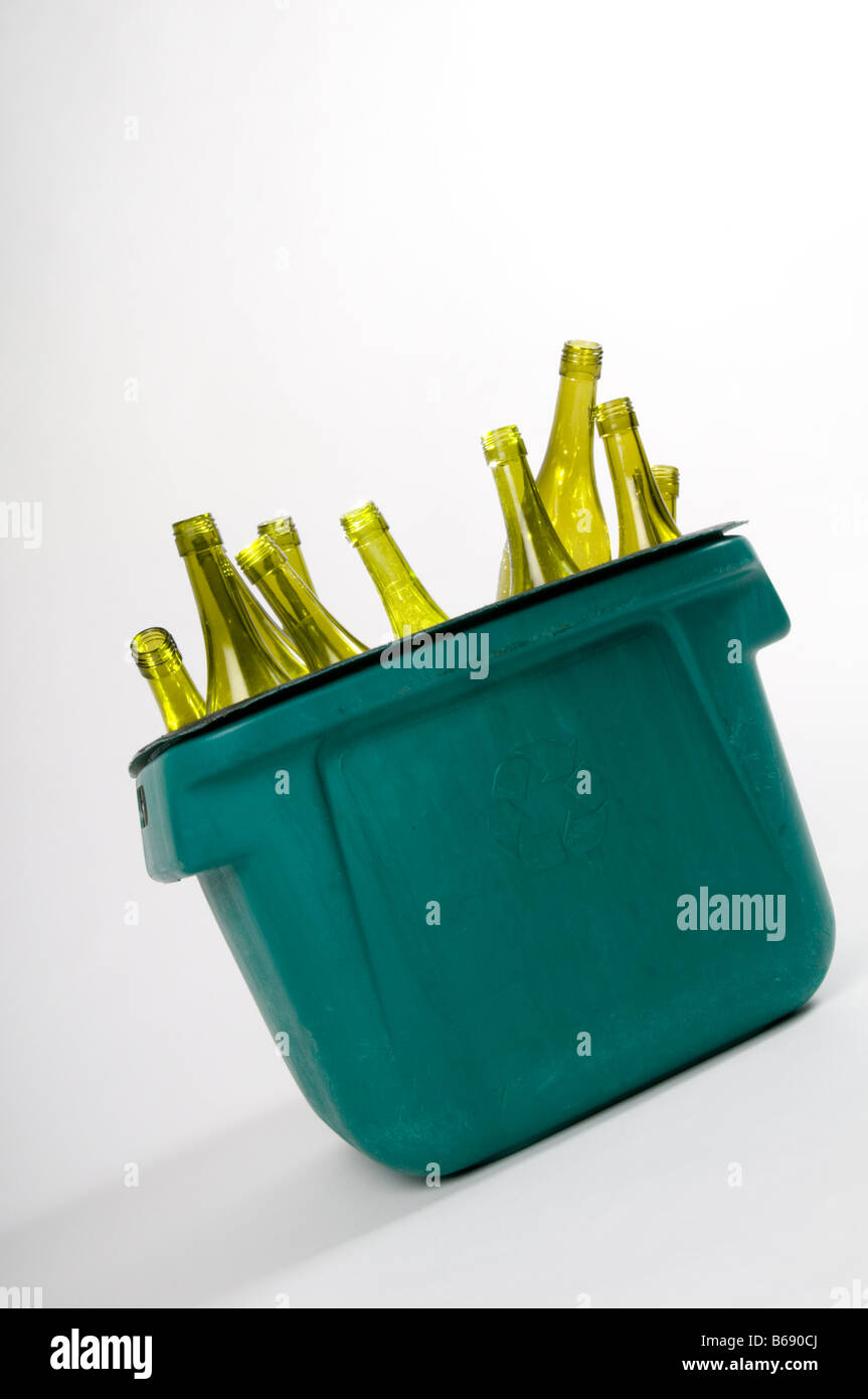 Green wine bottles in kerbside recycling crate Stock Photo