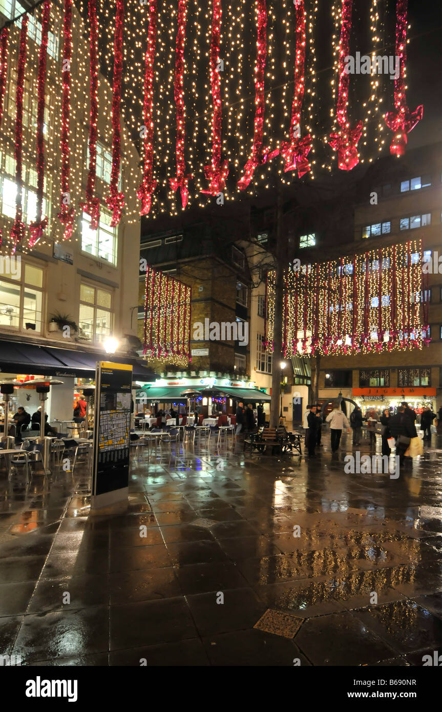 Christmas lights in St Christophers Place shopping & eating out area off Oxford Street in Londons West End rainy - Stock Image