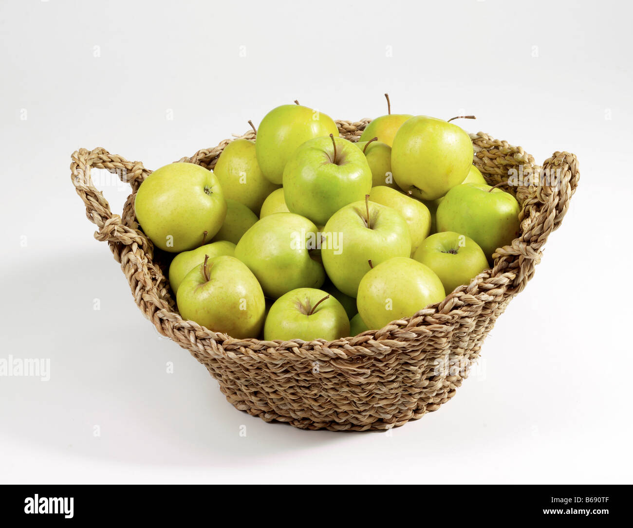 golden delicious apples basket white background Stock Photo
