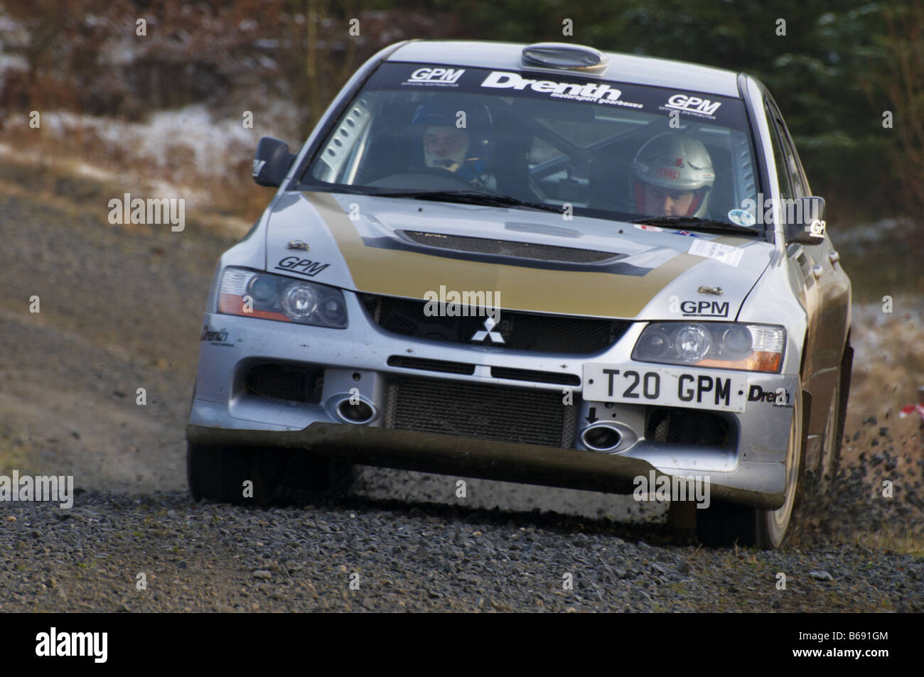 Rally Car on a special forest stage of a motor sport rally. Grizedale Forest Cumbria - Stock Image