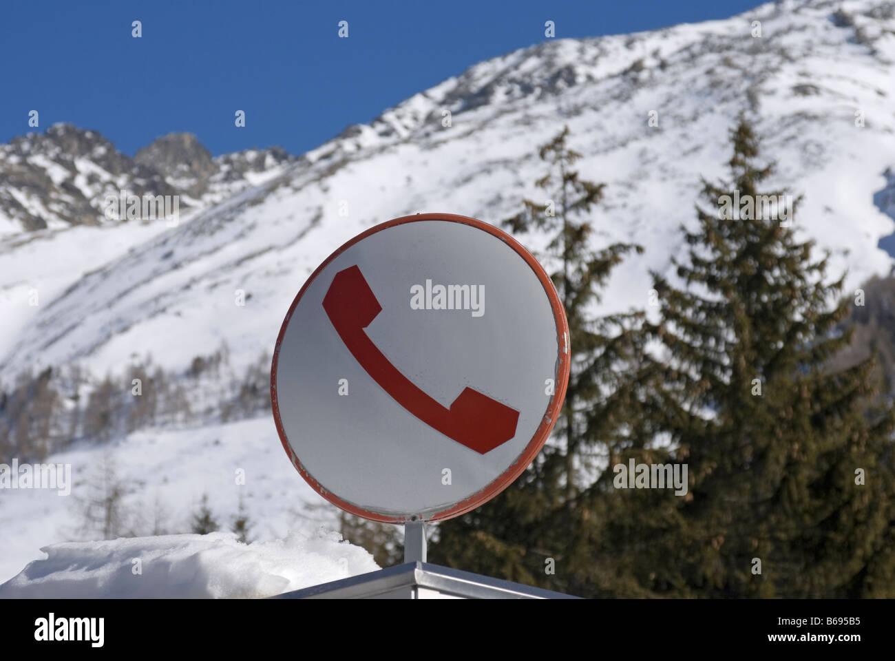 telephone box sign on the Italian AlpsStock Photo