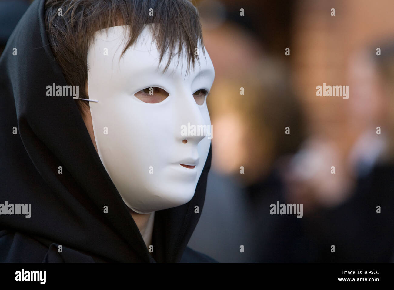 Masked player from the Play on Words Theatre company at the Dicken's Christmas parade Rochester Kent December - Stock Image