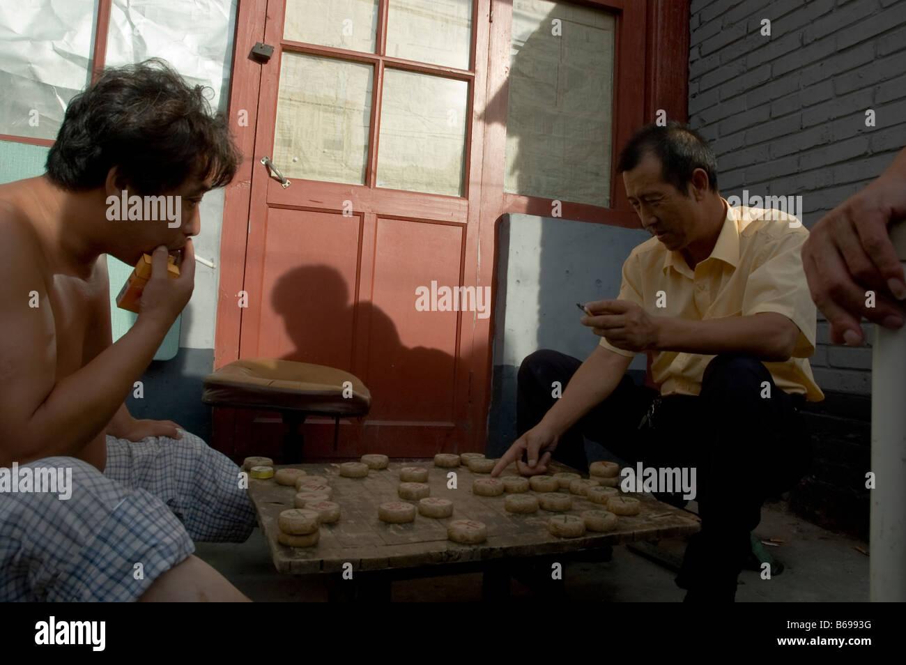two men play chinese chess (xiangqi) - Stock Image