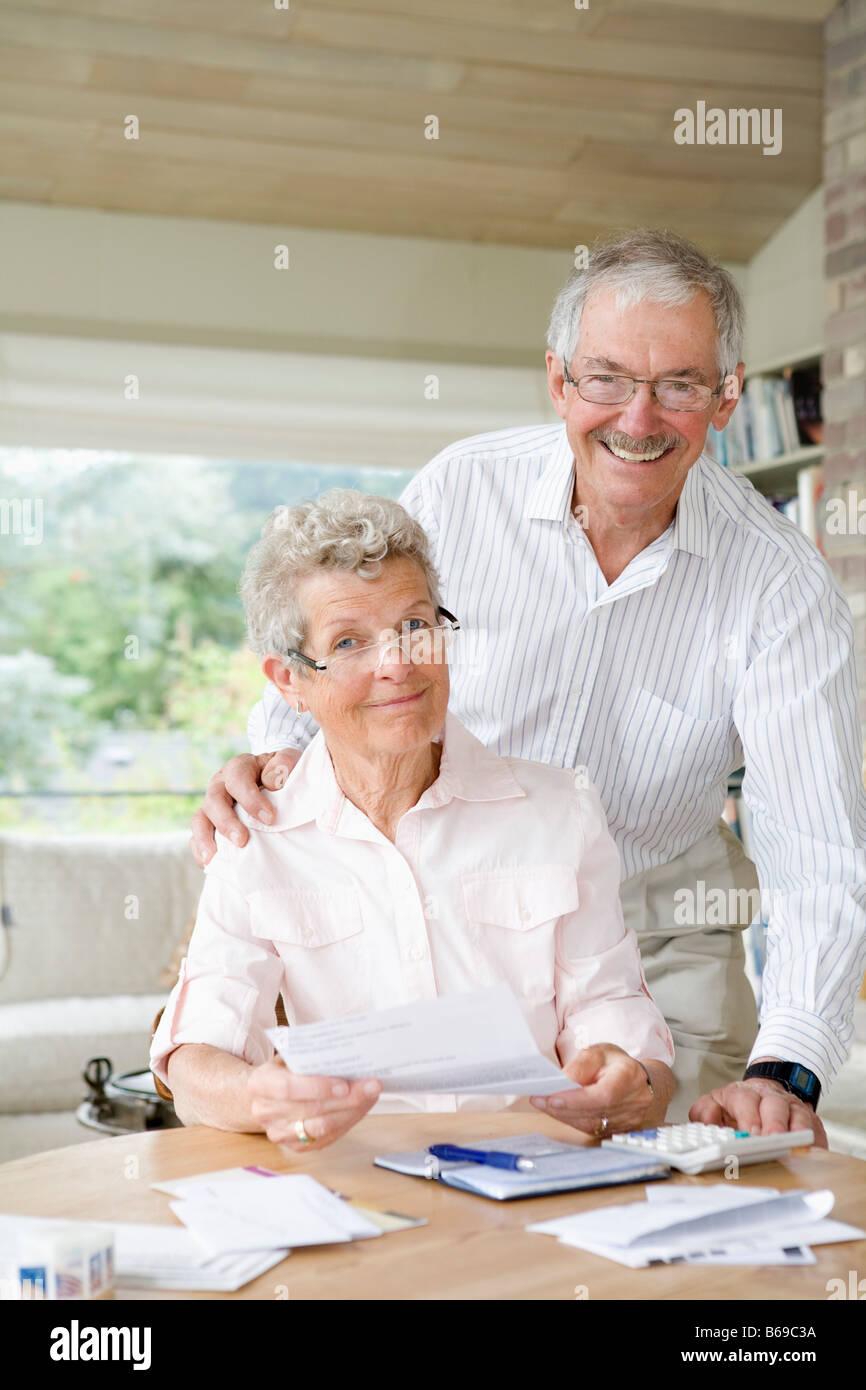 Couple preparing home finance budget Stock Photo