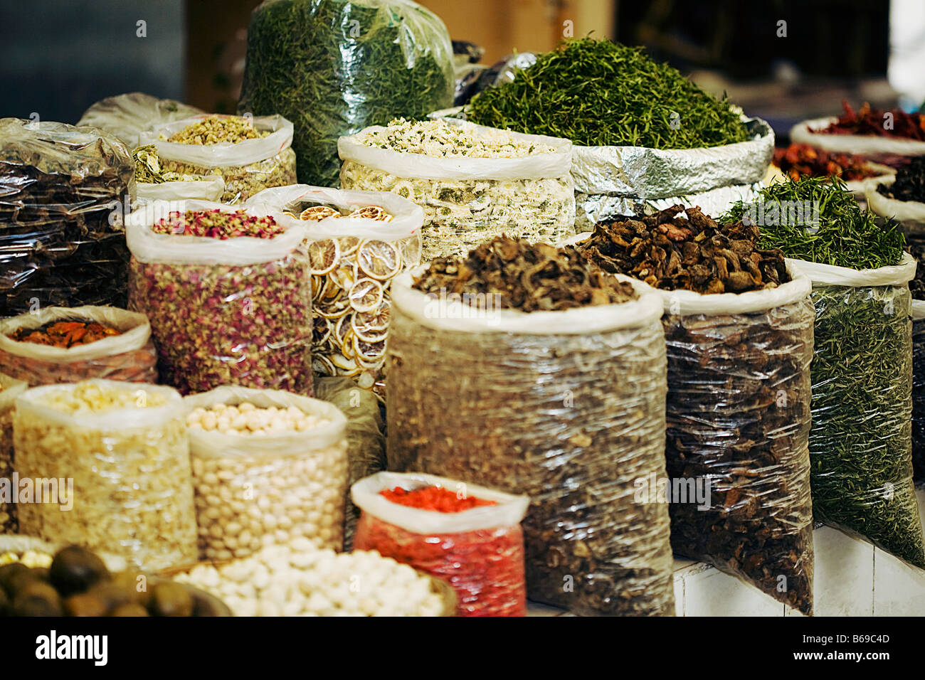 Sacks of herbs and spices at a market stall, Tai'an, Shandong Province, China - Stock Image