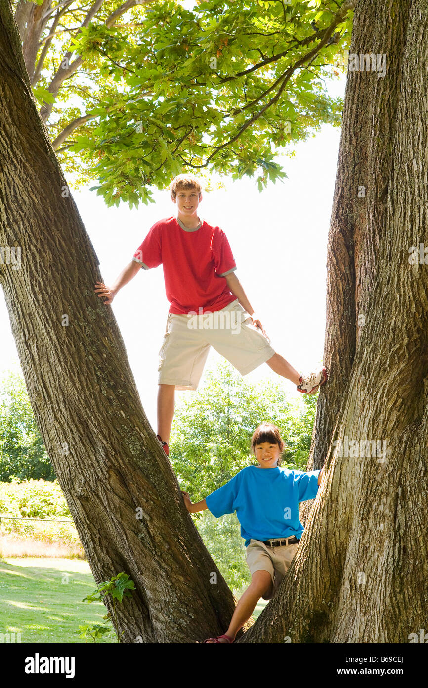 Two friends playing in a park - Stock Image