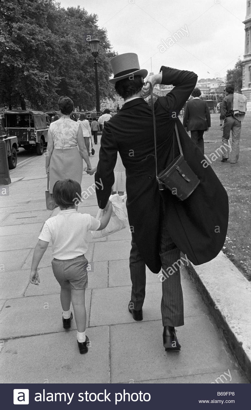 The English at play in the 1970s Part 2 Father in morning dress and son on their way to the Trooping the Colour - Stock Image
