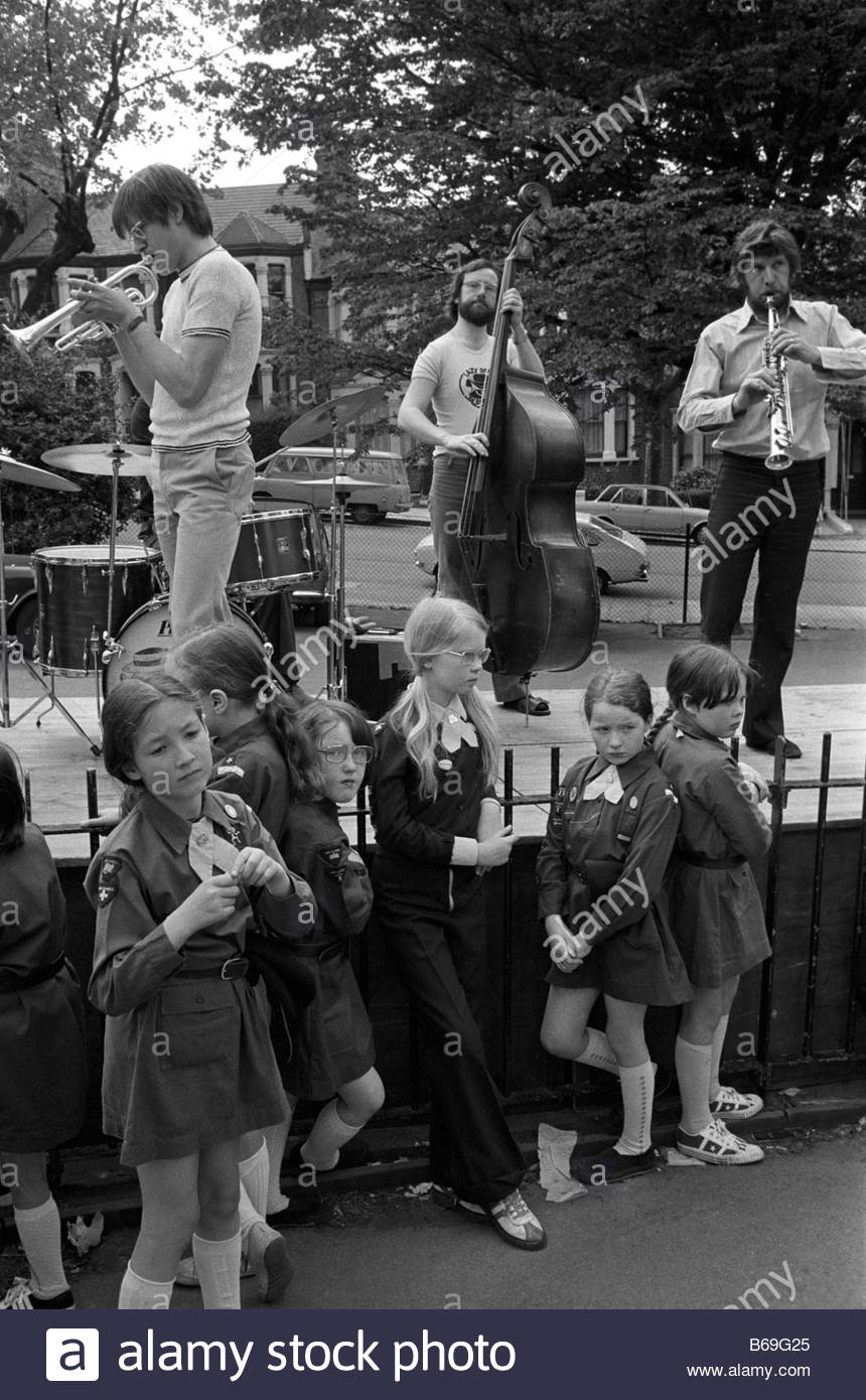 The English at play in the 1970s Part 2 Brownies and a jazz band in a London park - Stock Image