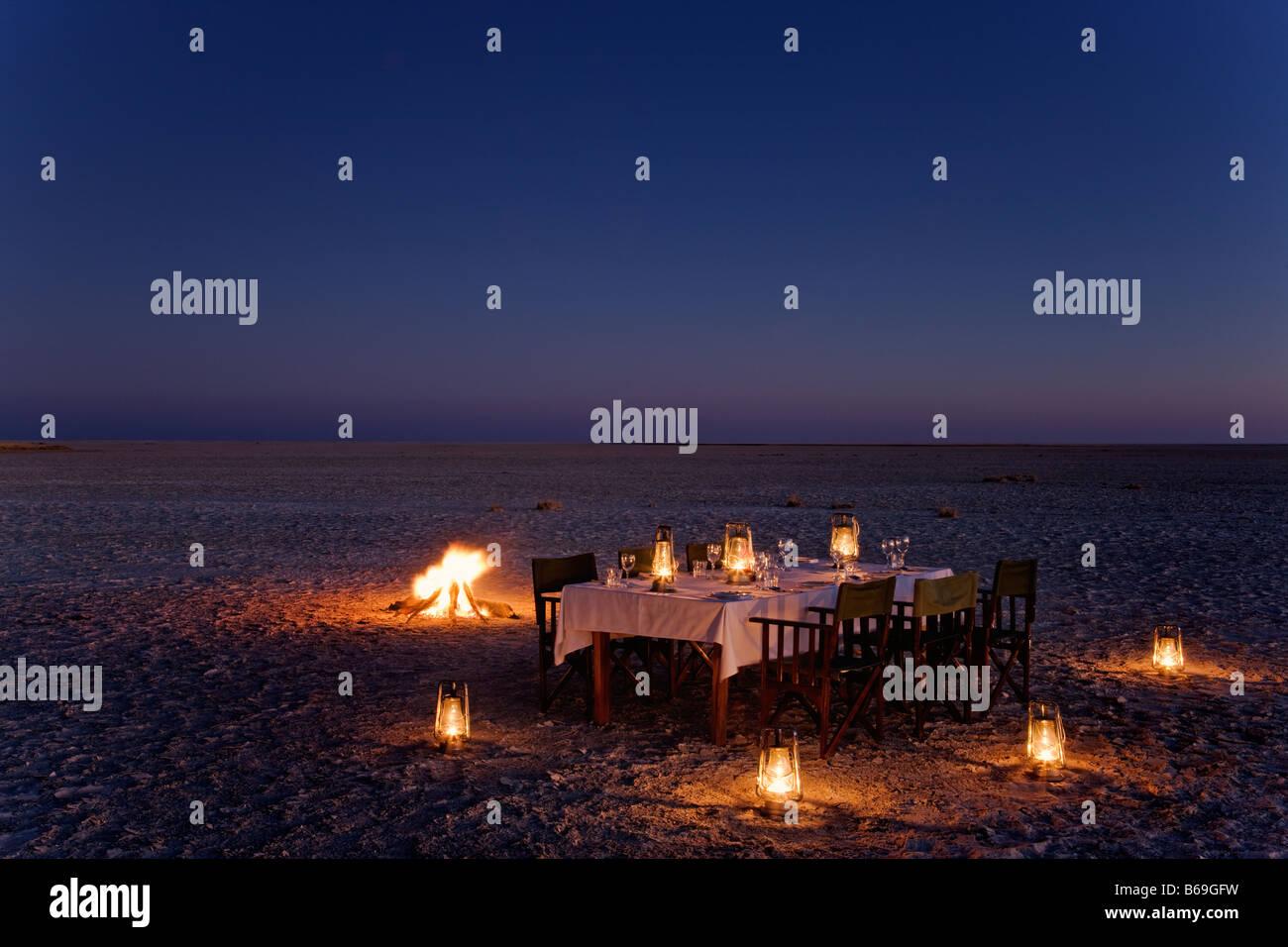 Dinner table set up on the Makgadikgadi Pans ack s Camp Botswana - Stock Image