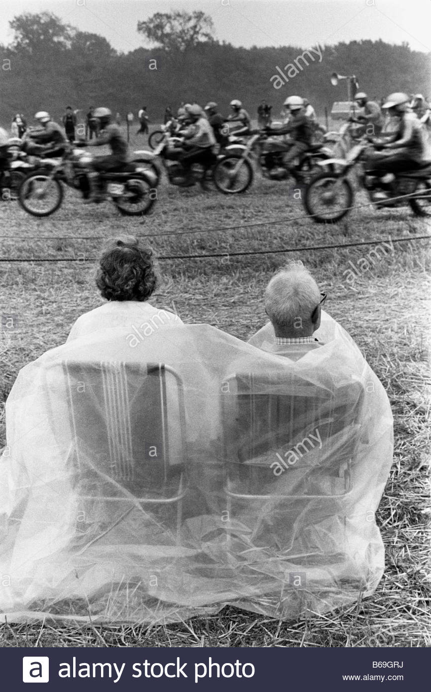 The English at play in the 1970s Part 2 Spectators at a motorcycle scramble in Suffolk - Stock Image