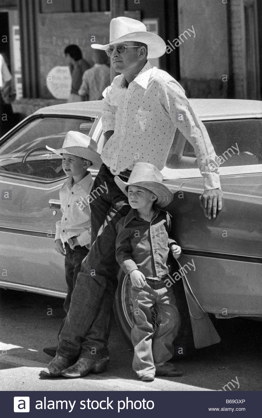 One year on the road in the USA during 1981 Father and sons at the 4th July celebrations in Eureka Nevada - Stock Image