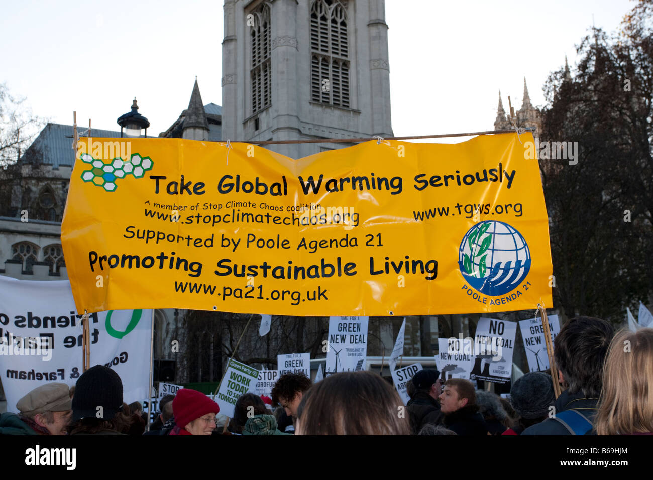 Campaigners with Take Global Warming Seriously banner on Climate Change March London December 2008 UK Stock Photo