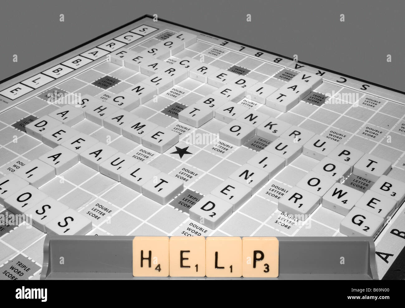 A scrabble game highlights global recession issues of the credit crunch and other financial implications and offers - Stock Image