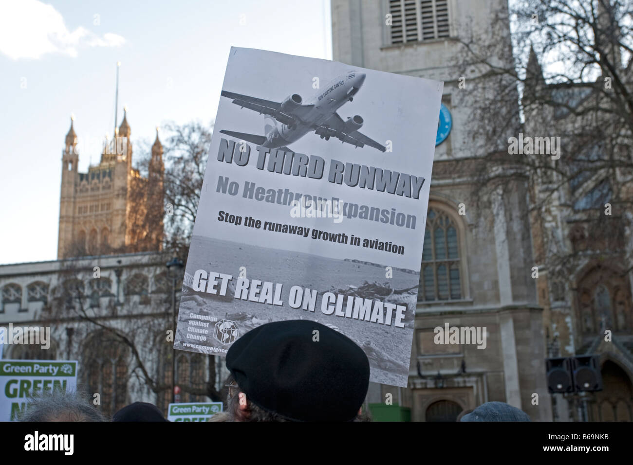 Campaigner with banner no third runway on Climate Change March London December 2008 UK - Stock Image