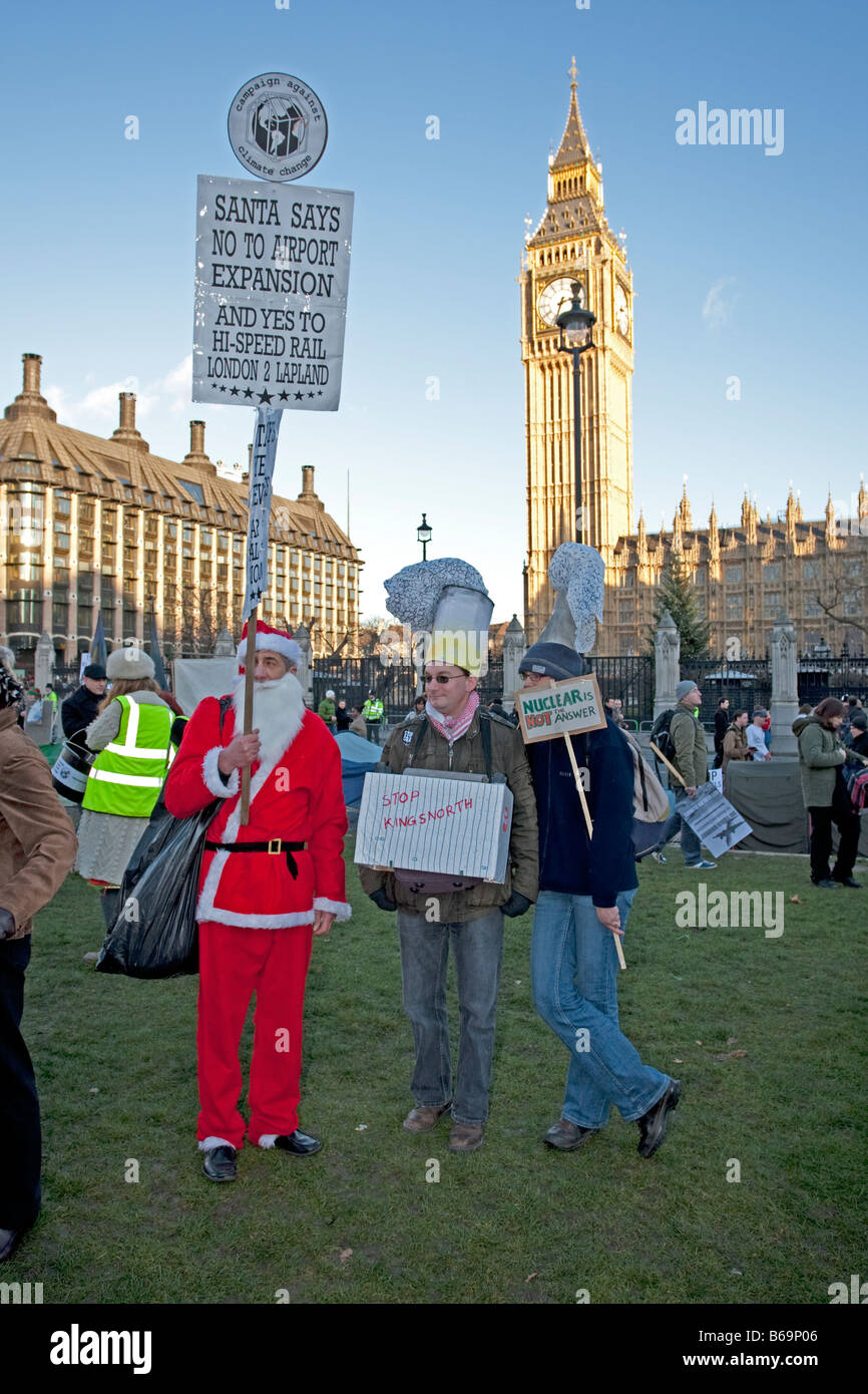 Santa says no to global warming and climate change outside parliament on Climate Change March London December 2008 - Stock Image