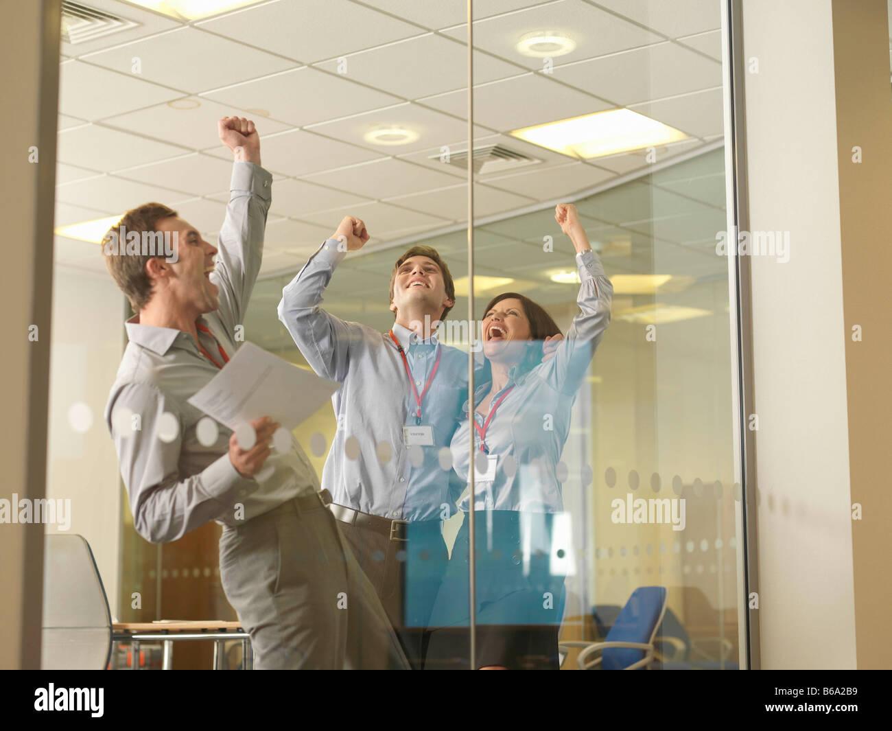 Office staff celebrating - Stock Image