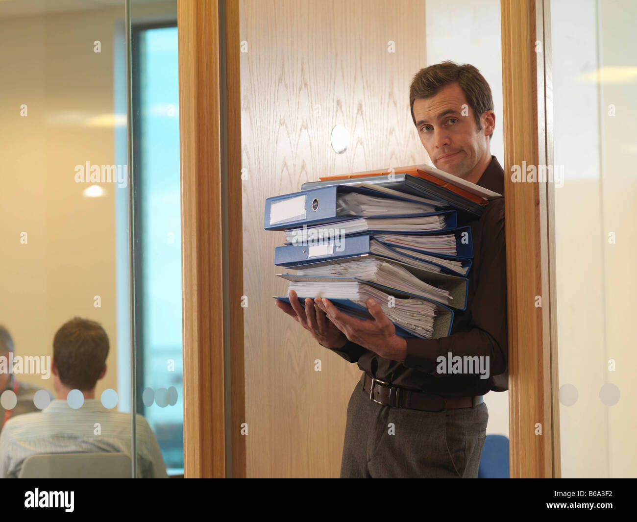 Office staff with files - Stock Image