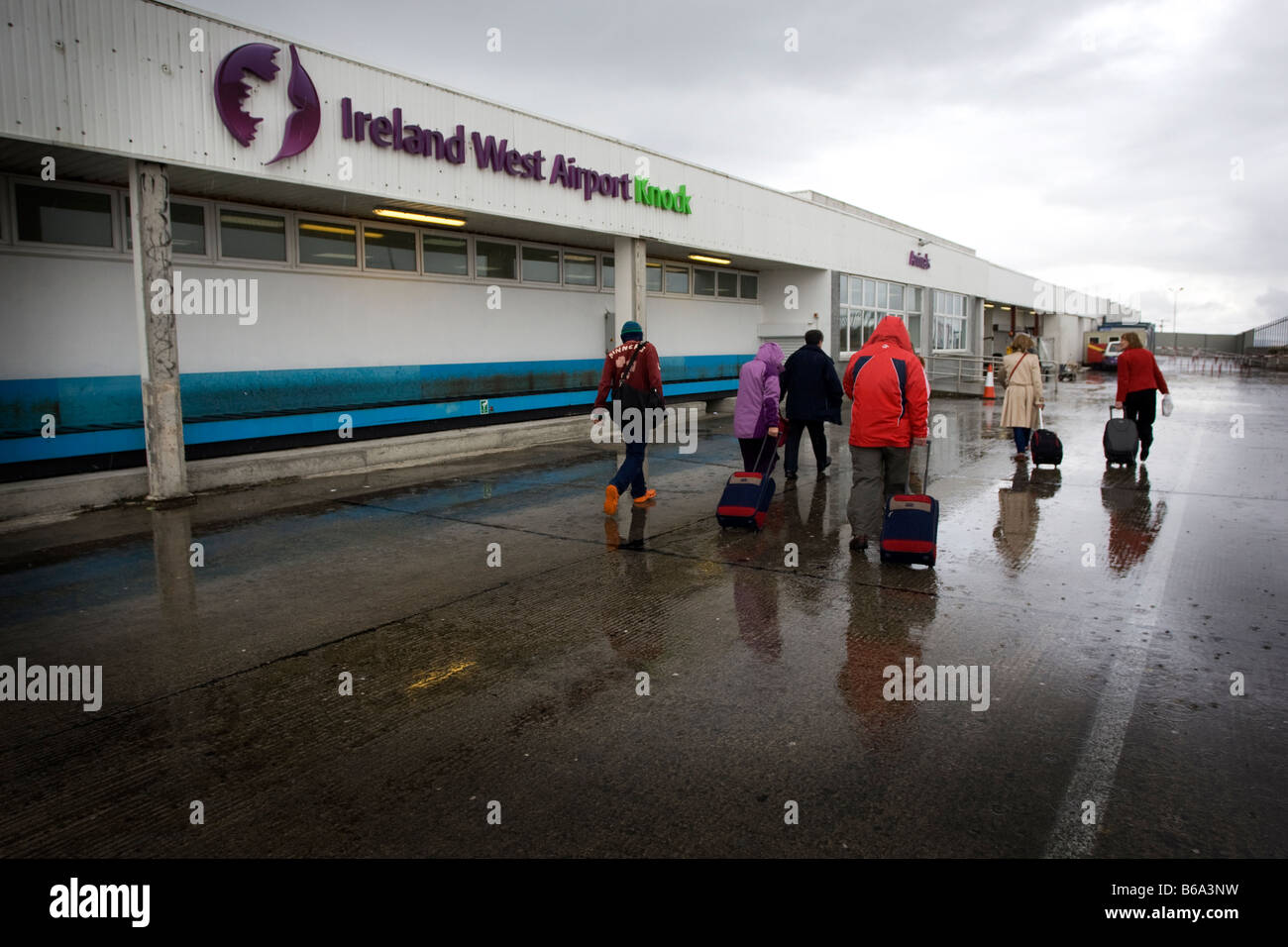 Wet tourists head for the main door at Knock Airport, West Ireland Stock Photo