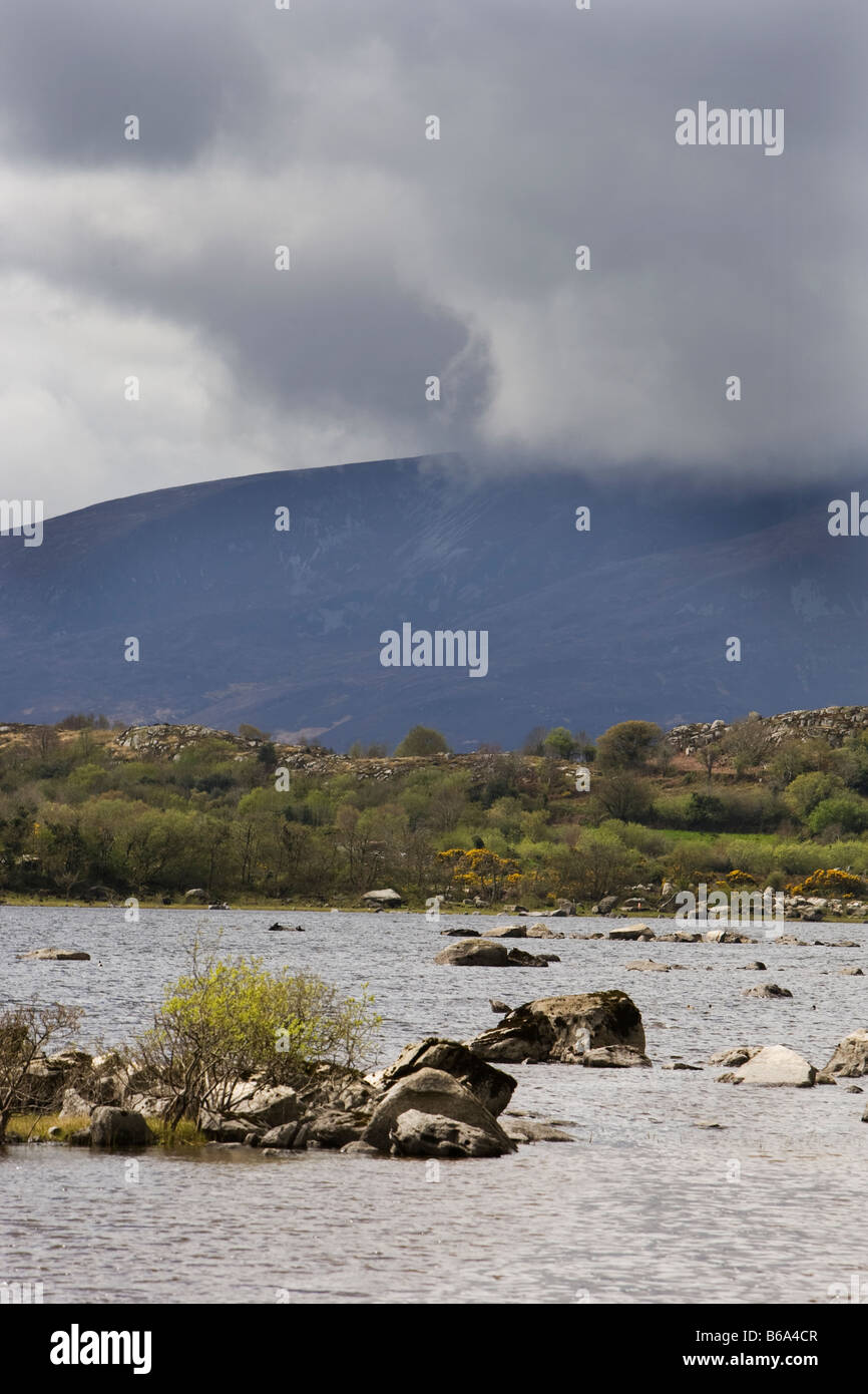 Mountain and lough in West Ireland - Stock Image