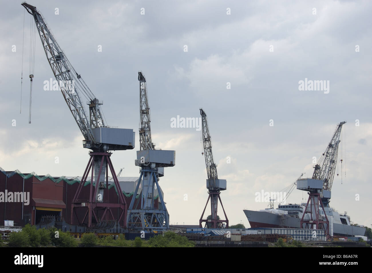 View of naval ship under construction at Govan shipyard from Partick in Glasgow Scotland - Stock Image