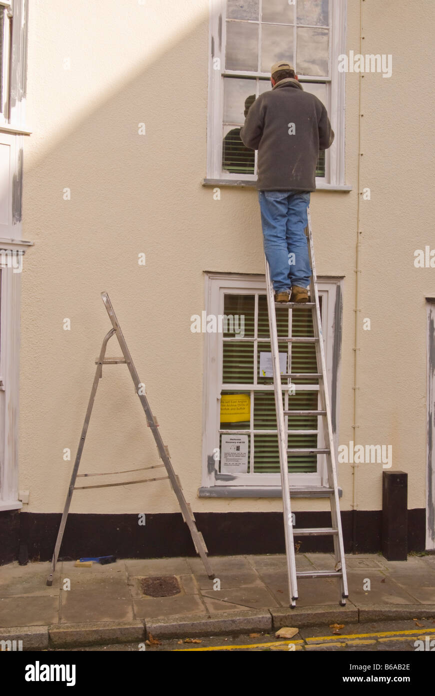 Strange Man Up A Ladder Painting And Decorating Exterior Outside Of Download Free Architecture Designs Ferenbritishbridgeorg