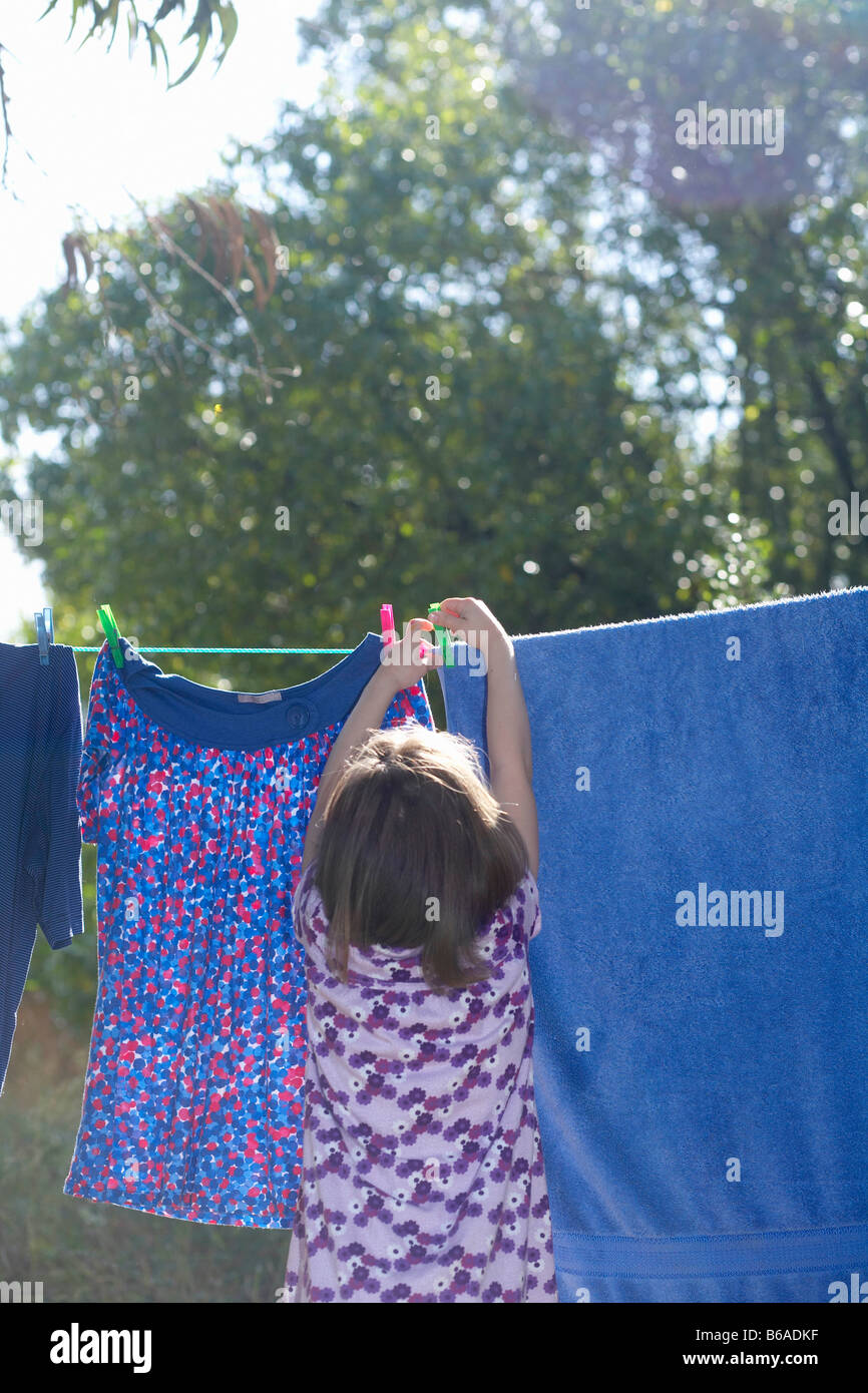 Young girl hanging washing - Stock Image