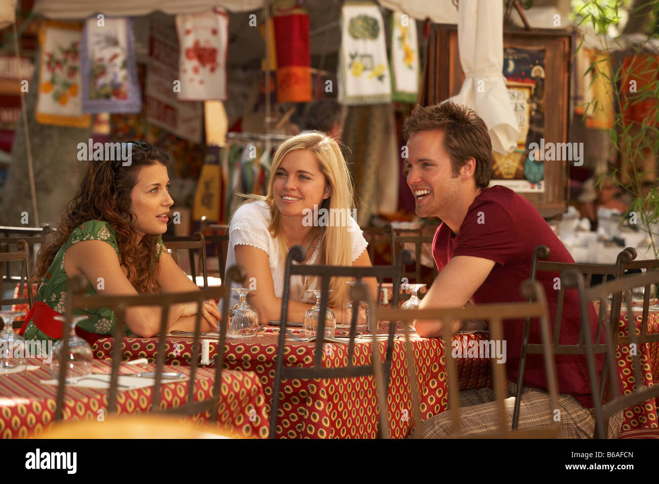 Friends talking in french market cafe Stock Photo