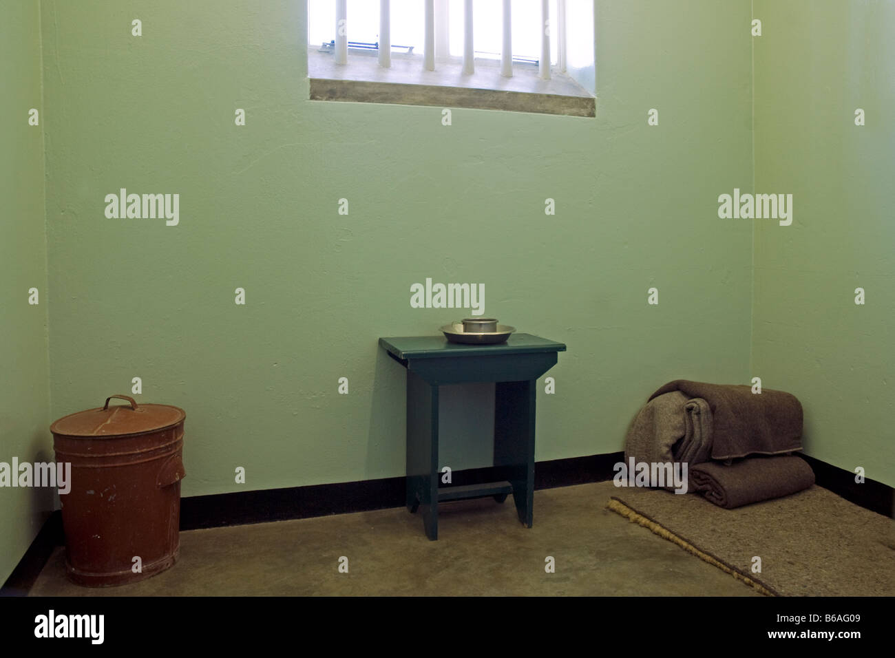 Prison cell of Nelson Mandela in Robben Island prison Cape Town South Africa - Stock Image