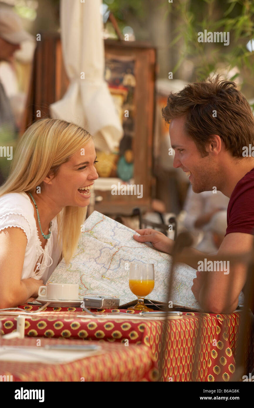 Couple laughing in french market cafe - Stock Image