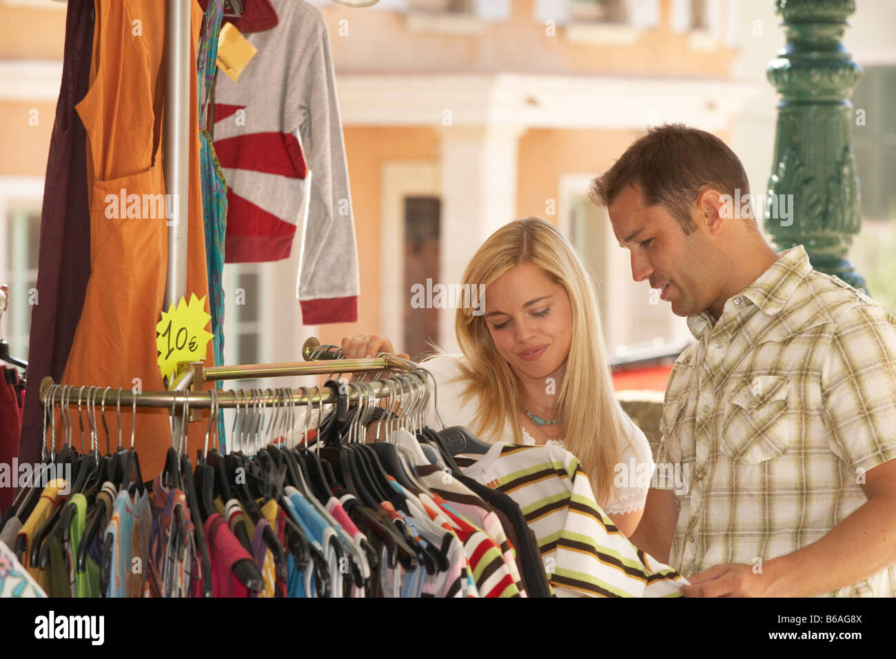 Couple shopping in french market - Stock Image
