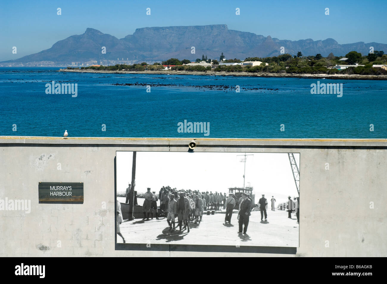 Historical photograph of prisoners arriving on Robben Island Cape Town South Africa Table Mountain in the background - Stock Image