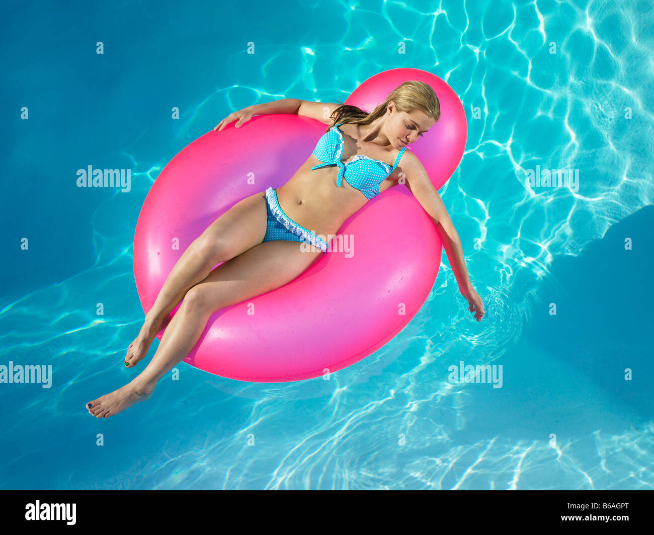 girl floating in inflatable raft stock photos girl. Black Bedroom Furniture Sets. Home Design Ideas