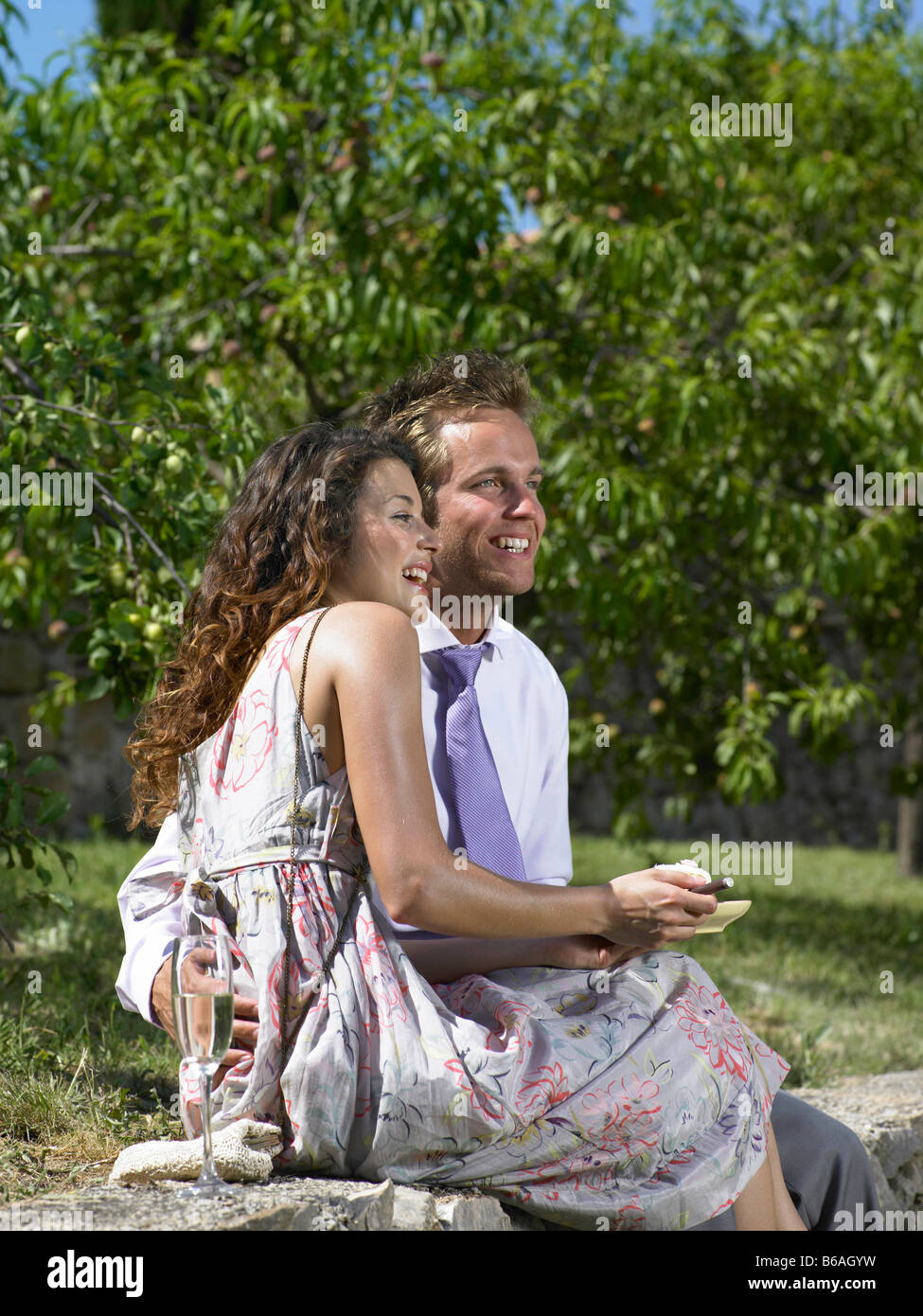 Wedding guests laughing - Stock Image